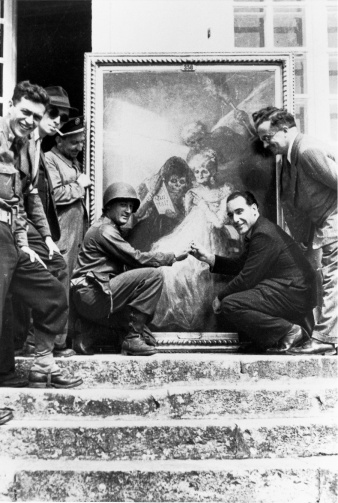JJR and Louvre curator Germain Bazin pose with Goya's painting, Time, which had been successfully protected during the war at Château de Sourches. AUGUST 1944. (National Archives and Records Administration, College Park, MD)