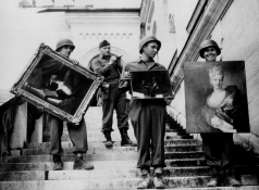 JJR with notebook on the steps of Neuschwanstein - MAY 1945. (National Archives and Records Administration, College Park, MD)